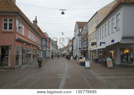 HELSINGOR, DENMARK - NOVEMBER 02, 2014: A cloudy november day in Helsingor. Tourists walk around the ancient streets. Denmark