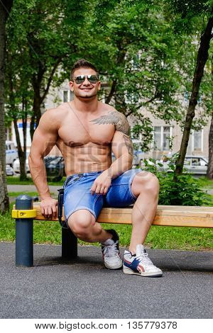 Handsome muscular man holding kettle bell with copy space. Crossfit workout theme.
