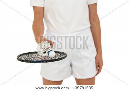 Athlete holding badminton racket and shuttlecock on white background
