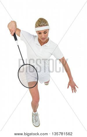 Badminton player playing badminton on white background