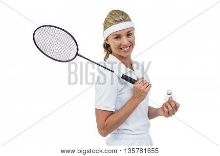 Badminton player holding badminton racket and shuttlecock on white background