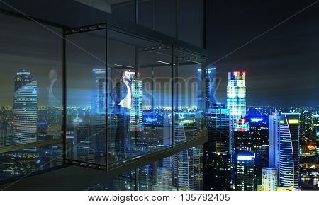 Thoughtful businessman looking into the distance from empty balcony interior on illuminated Singapore city background at night. 3D Rendering