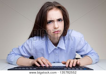 Frowning Girl Using Keyboard