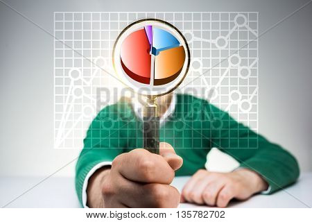 Young man in green pullover with business pie chart inside magnifier instead of head on light background. Concept of financial research