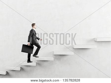 Success concept with businessman climbing abstract concrete ladder on wall