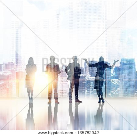 Businessmen and women silhouettes on New York city background with sunlight. Concept of teamwork and partnership. Double exposure