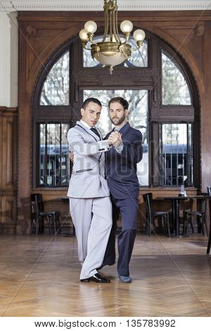 Male Tango Partners Performing In Restaurant