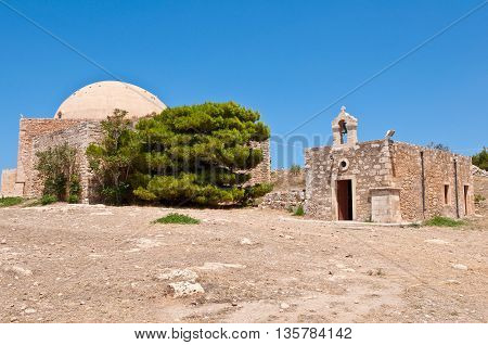 Sultan Ibrahim mosque and church of Agia Ekaterini on Crete Greece. Rethymno city. Crete Greece.