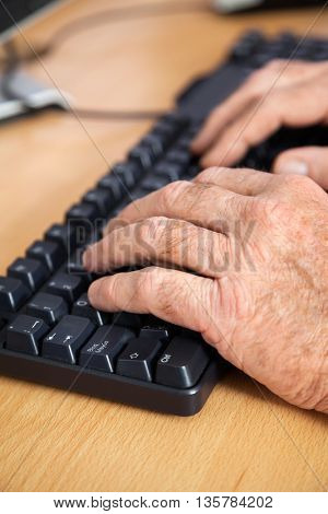 Senior Student Using Keyboard In Classroom