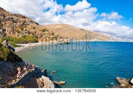CRETEGREECE-JULY 23:Holidaymakers go down the steps to the Preveli Beach on July 232014 on CreteGreece. Preveli beach is situated 40 km south of Retimno and is the most idyllic beach in Crete.