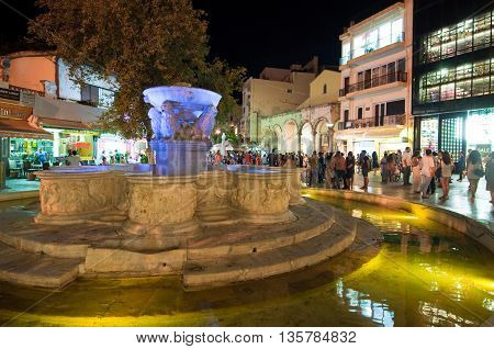 CRETEHERAKLION-JULY 24: The fountain in Lions Square on July 242014 on the Cete island Greece. Lions Square is a square in the city of Heraklion in Crete.