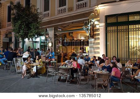 CRETE HERAKLION-JULY 24: Nightlife in Heraklion city next to Lions Square on July 24 2014 on the island of Crete in Greece.