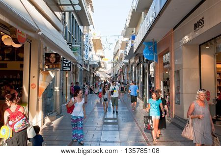 CRETE HERAKLION-JULY 25: Shopping street Dedalou on July 25 2014 in Heraklion on the island of Crete Greece. Daidalou Street is a paved pedestrian street with tourist shops.