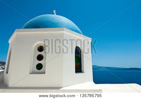 Detail of Oia church with blue cupola on the island of Thera (Santorini). The Cyclades Greece.