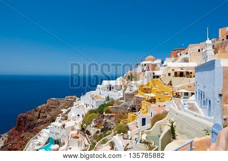 Colorful Oia and detail of the port Ammoudi below on the island of Thira (Santorini) Greece.