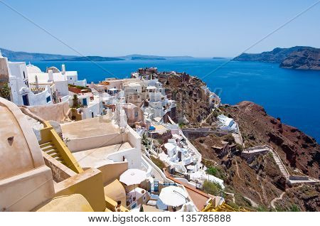 View of Oia town and the castle of Oia towards Thirassia Thera (Santorini)Greece.
