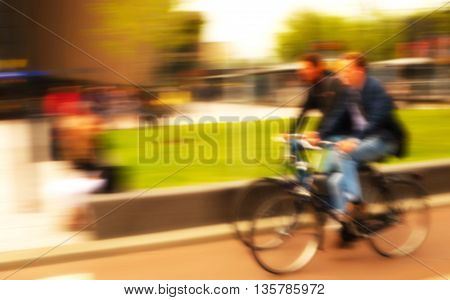 blur two bicycle with two men abstract