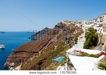 SANTORINIFIRA-JULY 28: Fira landscape on the top of the caldera on July 282014 in Fira town on Santorini Greece. Fira is the modern capital of the Greek Aegean island Santorini.
