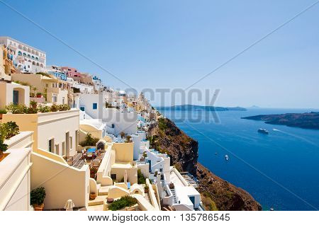 Fira cityscape on the edge of the caldera cliff on the island of Thira known as Santorini Greece.