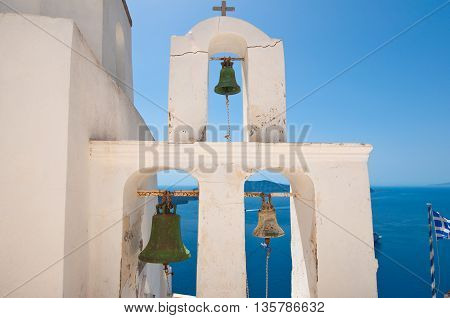 Detail of the bell tower of a Orthodox church. Fira town Santorini Greece.