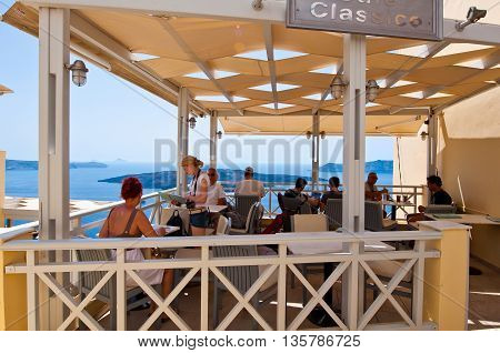 SANTORINI FIRA-JULY 28: Local restaurant with volcano view on July 28 2014 in Fira town on the Santorini island Greece. Firá is the modern capital of the Greek Aegean island Santorini.
