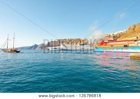 SANTORINI-JULY 28: Ferrys arrive to the port of Thira on July 28 2014 on the Santorini(Thera) island Greece.