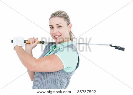 Pretty blonde posing with golf equipment on white background