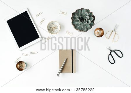 feminini desk workspace with succulent tablet scissors diary and golden clips on white background. flat lay top view
