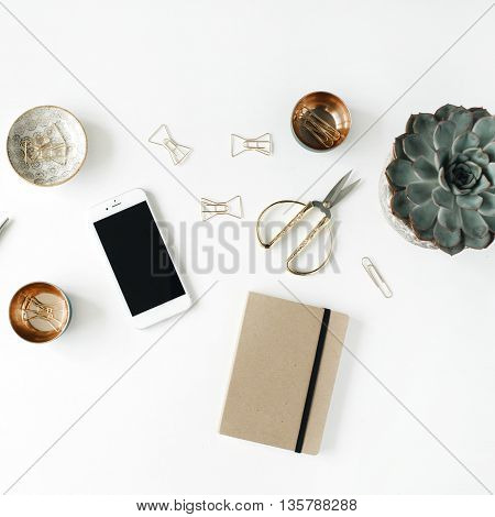 feminini desk workspace with succulent phone scissors diary and golden clips on white background. flat lay top view