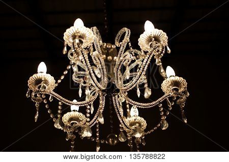 luxury vintage chandelier lamp on dark background