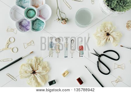 family with grandmother parents and young couple painted with watercolor and bow tie clips scissors dry tulip palette succulent on white background. flat lay top view