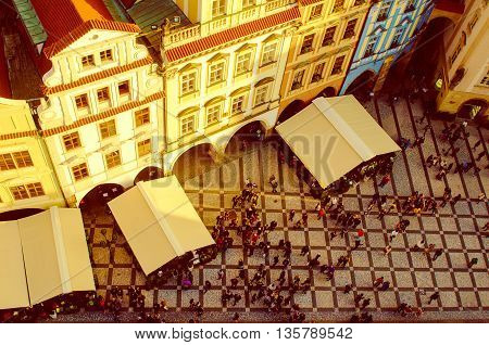 Red Prague roofs and square with lot of small people - view from the City Hall, travel european background