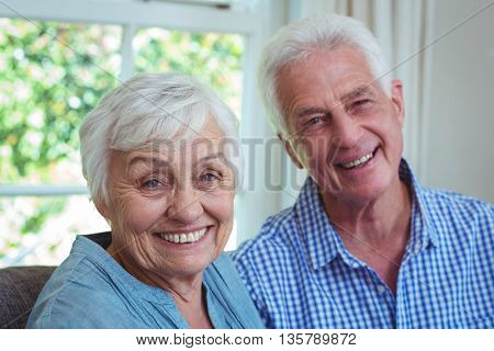 Close-up portrait of senior couple at home