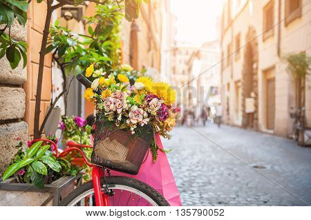 Bicycle With Flowers In The Old Street In Rome, Italy