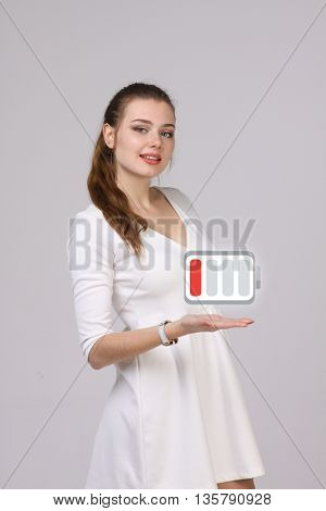 Young Businesswoman and battery level icon