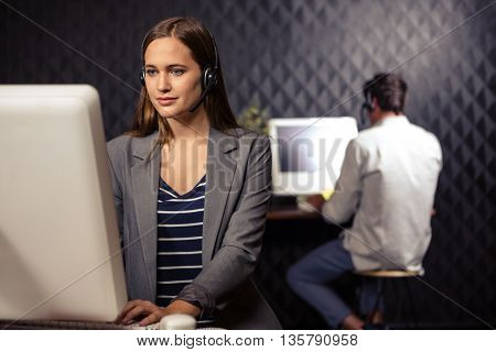 Creative businesswoman using a headset in office