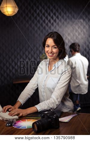 Creative designer woman working on computer in office
