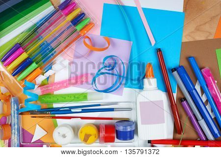 Top view artwork workplace with creative accessories. Flat lay art tools for painting and drawing