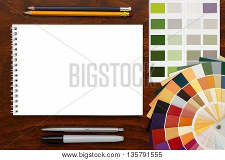 Color palette guide on the wooden background and notepad. mockup template