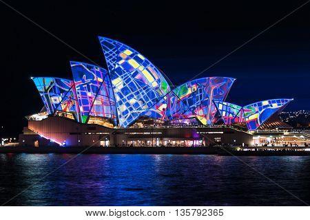 Sydney Australia - May 27 2016: Annual outdoor lighting festival Vivid Sydney: Festival of Light Music and Ideas. Sydney Opera House illumination Lighting the Sails Songlines. Long Exposure