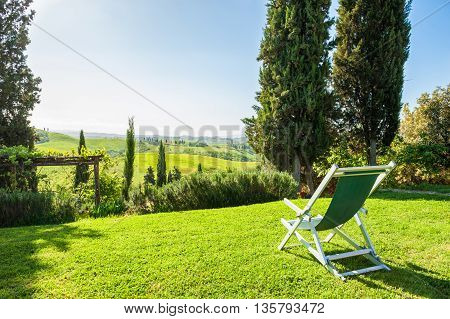 Deck Chair On The Green Meadow