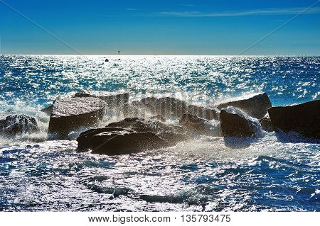 Seascape with Stones with waves splashes glow