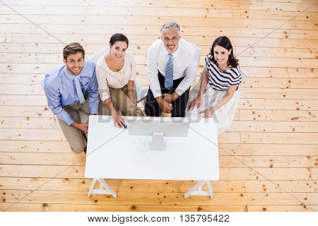 Portrait of Business people sitting at desk using computer