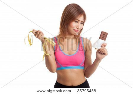 Unhappy Asian Healthy Girl With Chocolate And Measuring Tape