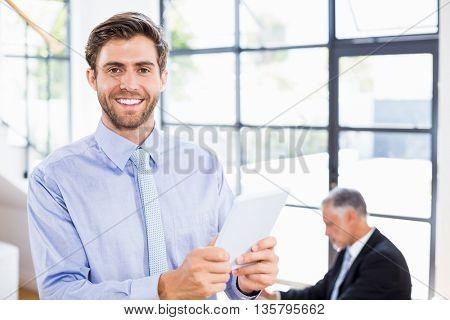 Businessman using digital tablet in office