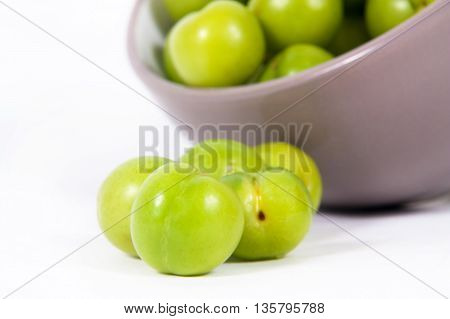 close up of cherry-plums on the white