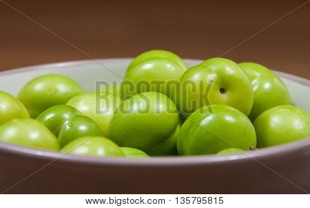 close up of cherry-plums on the table