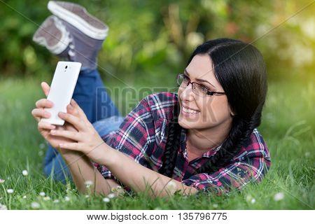 Girl Taking Selfie In The Park