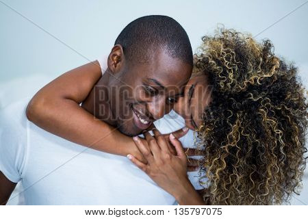 Young couple embracing each other in bedroom at home