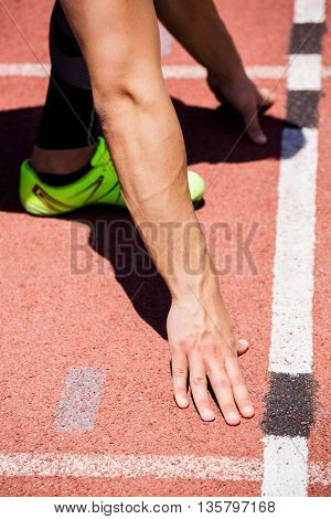 Athletes hands on a starting block about to run